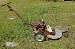 Old three wheeled lawn mower Stock Photo