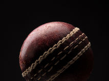 Old throw ball on dark background. Close up of an old throw ball on dark background stock photography