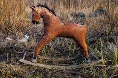 Old thrown away rocking horse Stock Images