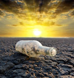 Old thrown out bottle Royalty Free Stock Images