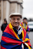 Old Tibetan. In France like many other Tibetans expelled from their own country. Political refugee. Paris, March 10th, 2012 Royalty Free Stock Photo