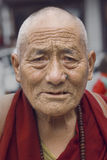 Old Tibetan Buddhist monk in the Dharamsala, India Royalty Free Stock Image