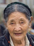 Old Tibetan Buddhist woman in the Dharamsala, India Royalty Free Stock Images