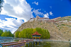 Old Tibetan fortress. Scenic view of old Tibetan fortress on mountainside under cloudscape Royalty Free Stock Photos