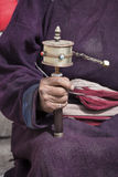 Old Tibetan man holding buddhist prayer wheel, Ladakh, India Stock Photo