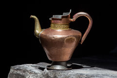 Old tibetan pitcher, close up Royalty Free Stock Images