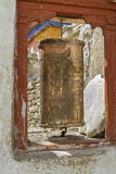 Old tibetan prayer wheel in Ladakh, India Stock Image