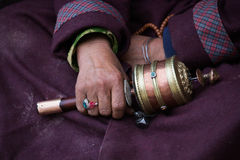 Old Tibetan woman holding buddhist prayer wheel, Ladakh, India Stock Photos