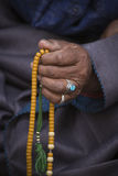 Old Tibetan woman holding buddhist rosary, Ladakh, India Royalty Free Stock Image