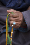 Old Tibetan woman holding buddhist rosary, Ladakh, India Royalty Free Stock Photography