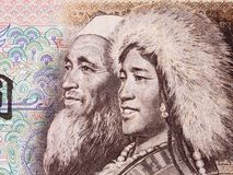 Old Tibetan and a woman from the Hui people portrait stock images