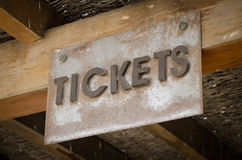 Old ticket sign. Sign saying Tickets. Worn and dusty Royalty Free Stock Photography