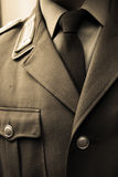 Old tie. Necktie and coat of an old military general Stock Photos