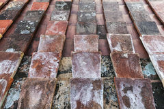 Old tile roof background texture with perspective Stock Image