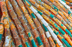 Old tile roof of the church closeup. Stock Photo