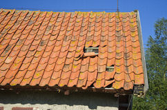 Old tile roof house fragment Stock Photos