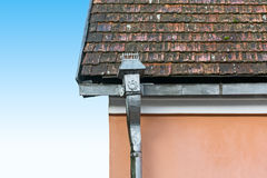 Old tile roof and rain gutter Royalty Free Stock Photo