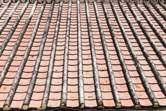 Old tile roof texture. Weathered surface of ancient roof Royalty Free Stock Photo