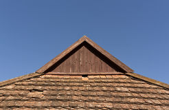 Old tile roof top against blue sky. Architectural background and texture for design Royalty Free Stock Images