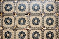 Old tile texture with simple floral elements Stock Image