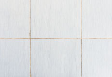 Old tile wall with the dirty grout. Old tile wall with the dirty grout in the kitchen of the urban house Royalty Free Stock Photos