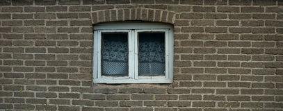 Old tile wall with window. Old rugged tile wall with window Royalty Free Stock Images