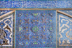 Old tiled design with traditional Persian patterns on wall Royalty Free Stock Image