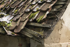 Old tiled house roof. Old Latvian house with tiled roof. Collapsed house Royalty Free Stock Image