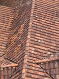 Old tiled roof. An old tiled roof with orange shingles Stock Image