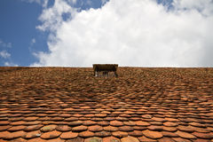 Old tiled roof with attick window Royalty Free Stock Image