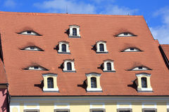 Old tile roof with windows look as eyes, Cheb - Czech Republic Stock Photography