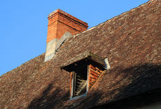 Old Tiled Roof with Chimneyand Attic Royalty Free Stock Image