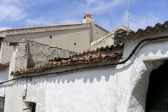 Old tiled roof, old stone wall with old textures, in a village i Royalty Free Stock Photos