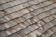 Old tiled roof. Old shabby and dirty, tiled roof stock photography