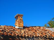 Old tiled roof with a small chimney Stock Images