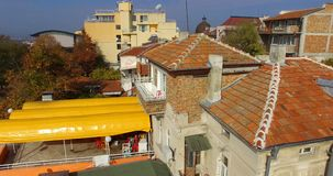 Old tiled roofs of the Bulgarian resort town of Pomorie stock footage