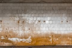 Old tiled wall of an industrial building Stock Photos