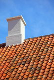 Old tiles red roof with himney sky background Royalty Free Stock Photo