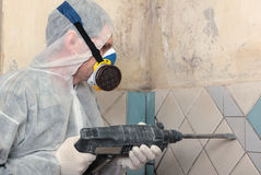 Old tiles removal. Contractor removing old tiles from the wall Stock Images