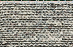Old tiles on the roof. Pattern of old tiles on the roof, damaged and ruined Royalty Free Stock Image