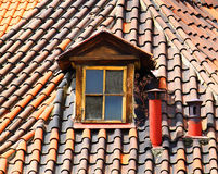 Old tiles roof and window Royalty Free Stock Photos