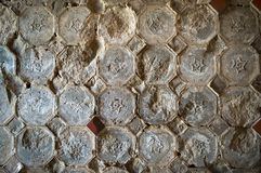 Old tiles on an old wall Royalty Free Stock Image
