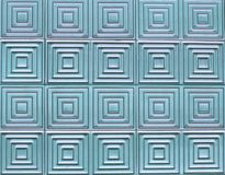 Old tiles on the wall with a unique square pattern. Old tiles on the wall with a unique square pattern, turquoise color Royalty Free Stock Image