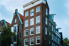 Old Tilted Houses in Amsterdam. Unique dutch architecture. House in narrow street stock image