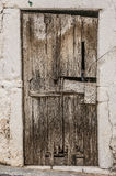 Old timber door in the scuffed wall Stock Photos