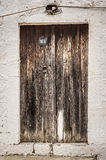 Old timber door in the scuffed wall Royalty Free Stock Photography