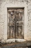 Old timber door in the scuffed wall Stock Images