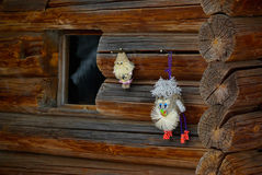Old timber house and homemade dolls. Window and homemade dolls on front of brown old timber house Stock Images