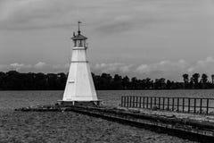 Old timber lighthouse and pier. Vadstena. Sweden. An old timber lighthouse at the end of the pier. Lake Vattern. Vadstena. Sweden royalty free stock image