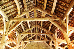 An old timber roof. Showing the construction of an old barn roof Stock Photo